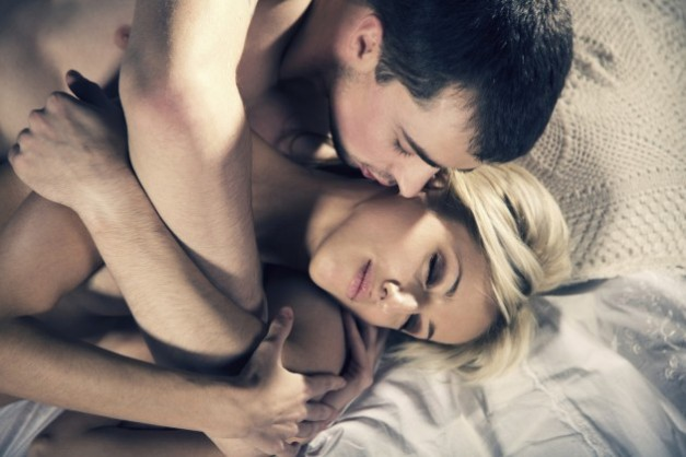 Couple-making-love-on-bed-1